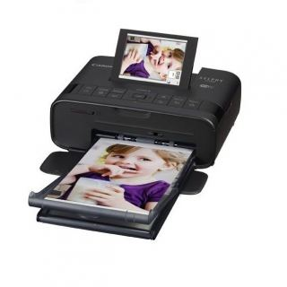 Canon Compact Photo Printer selphy CP1300 Black with 54 sheets + Ink